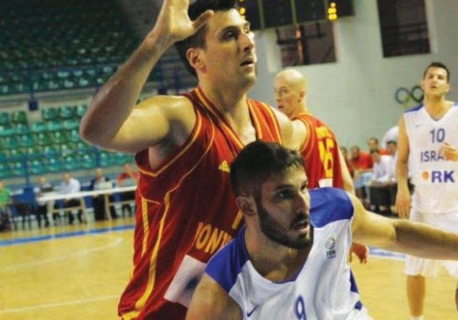 Israel's Omri Casspi and Vladimir Dragicevic of Montenegro