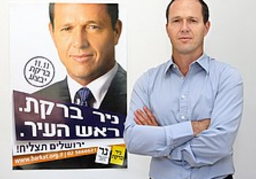 barkat and a poster of himself