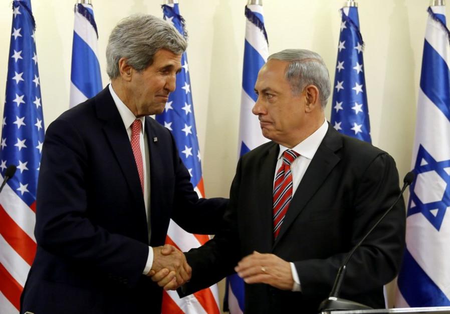 Prime Minister Benjamin Netanyahu (R) shakes hands with US Secretary of State John Kerry