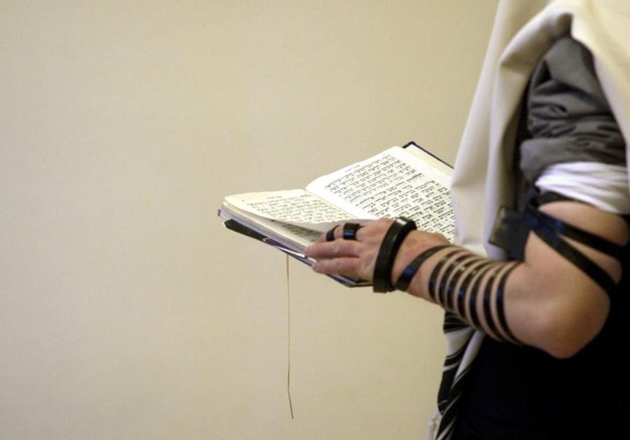 An Orthodox Jew prays