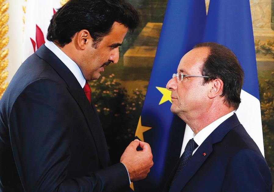 FRENCH PRESIDENT Francois Hollande (R) and Qatar's Sheikh Tamim bin Hamad al-Thani.