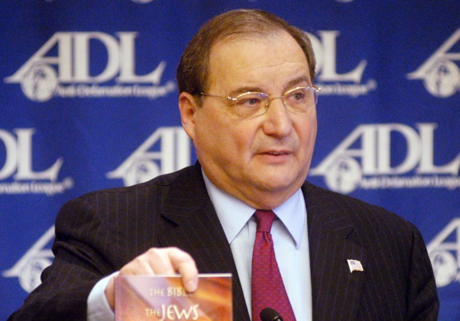 "Abraham H. Foxman, National Director of the Anti-Defamation League, shows the book ""The Bible, the J"