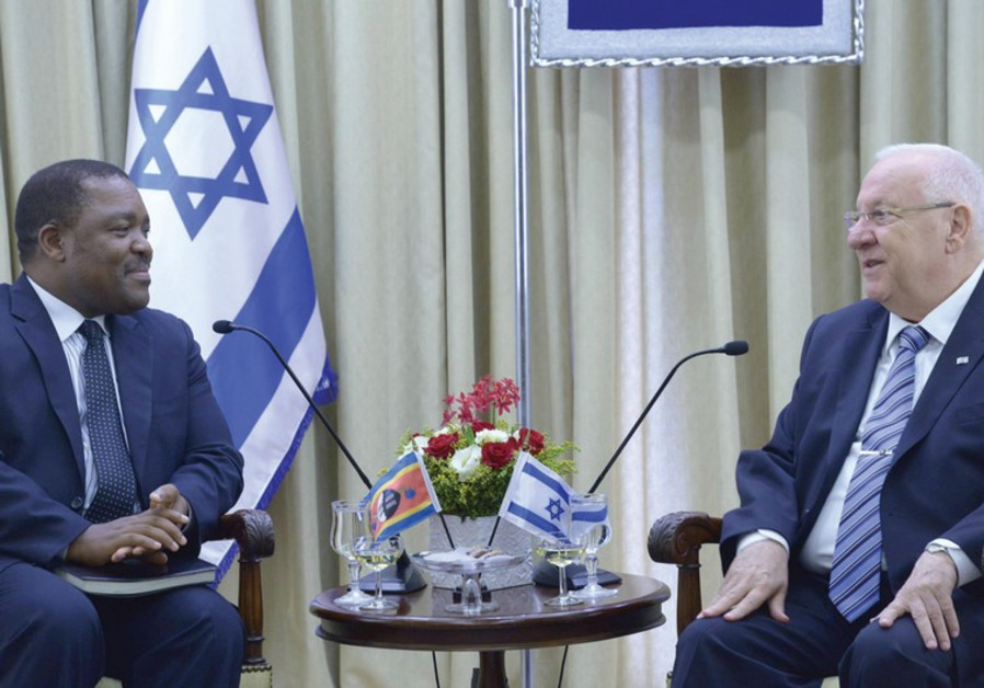 PRESIDENT REUVEN RIVLIN (R) and Ambassador Promise Msibi of Swaziland.