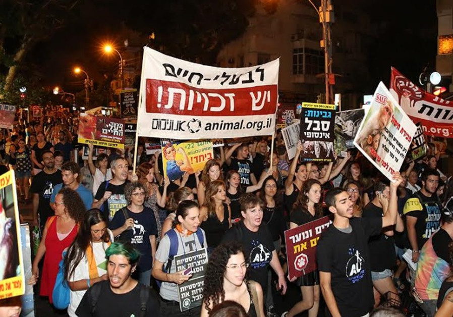 Animal rights activists marching in Tel Aviv, Sept 19, 2014