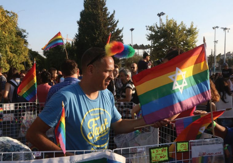 Celebrants march in the gay pride parade.