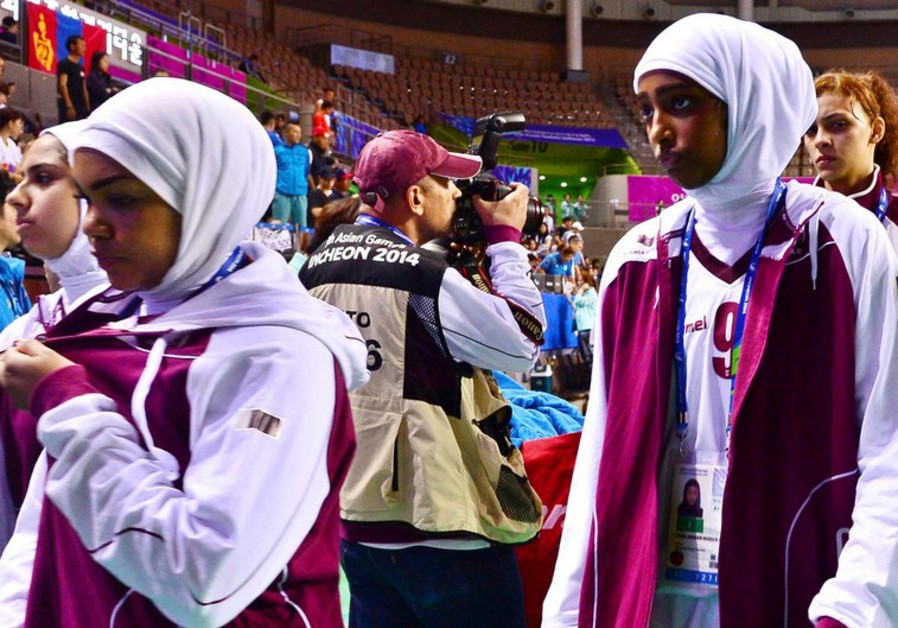 Qatar women's basketball team walking off the court at the Asian Games.