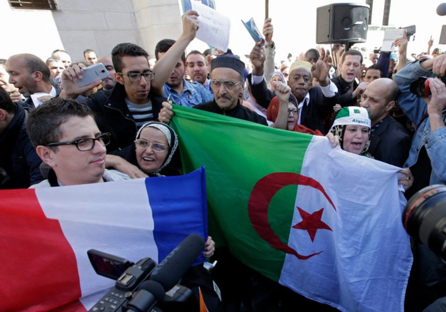 Muslims in Paris rally to honor Frenchman killed by jihadists