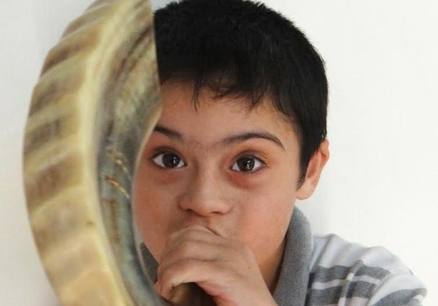 A boy named David blows the shofar at SHALVA.