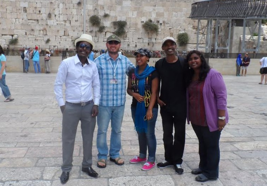 Students with guide at the Western Wall in Jerusalem