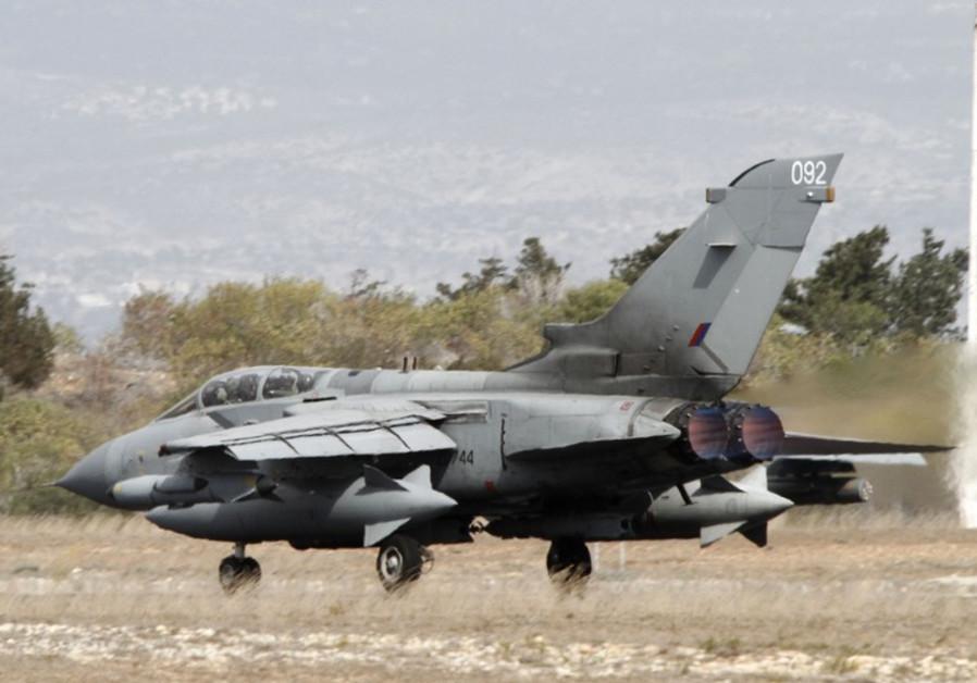 A British Tornado jet prepares to takeoff at the RAF Akrotiri in Cyprus September 27, 2014