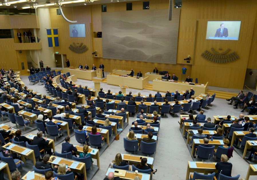 Sweden's Prime minister Stefan Lofven (standing C) announces his new government during a Parliament