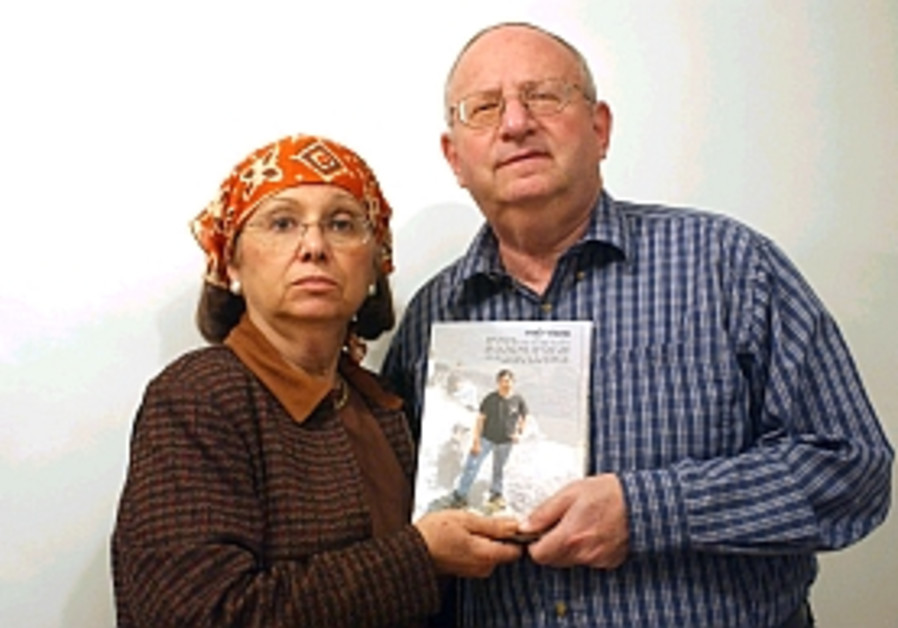 Stanley and Joyce Boim hold a photo of their son David who was murdered by terrorists. Credit: Ariel Jerozolimski