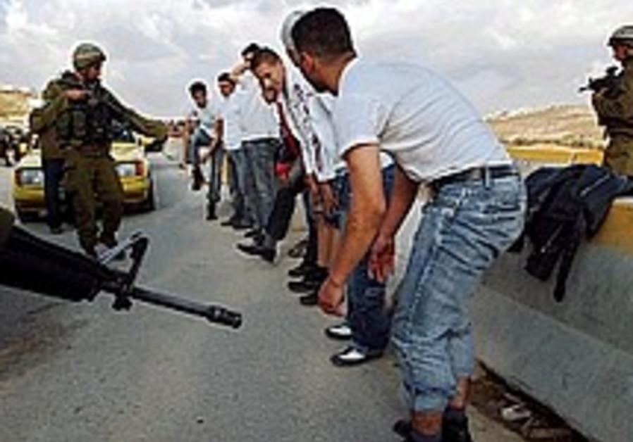 idf soldiers check row of palestinians hawara 298