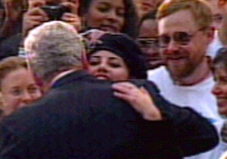 Monica Lewinsky hugs President Clinton