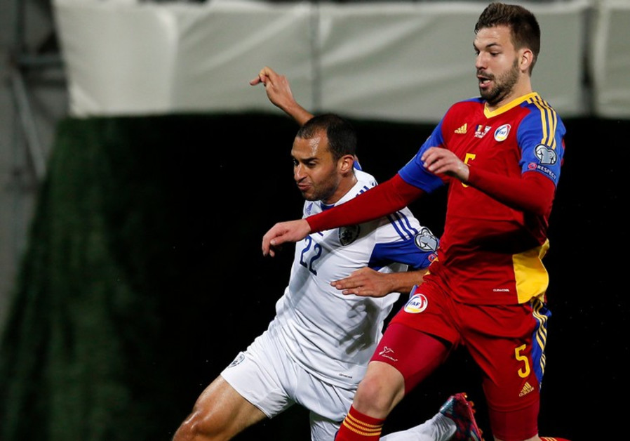 Israel's Omer Damari (L) fights for the ball against Andorra's Emili Garcia