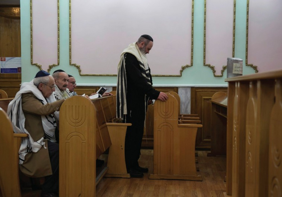 JEWS ATTEND the morning prayer