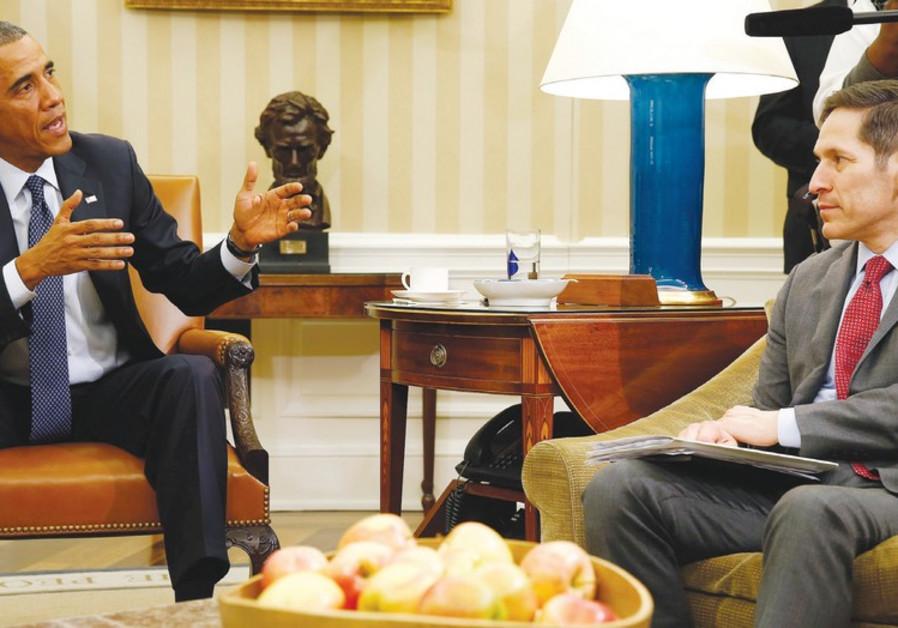 US PRESIDENT Barack Obama speaks with Tom Frieden