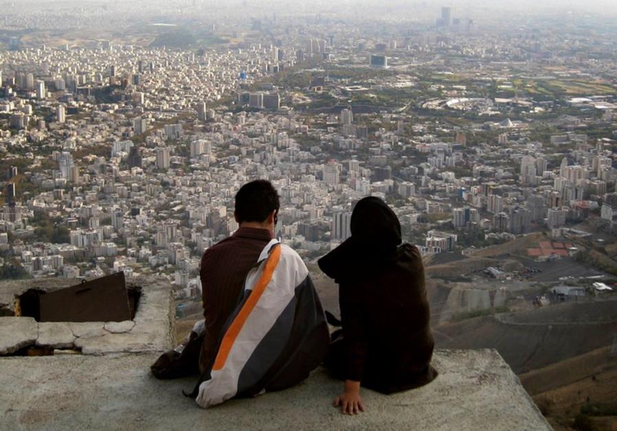 Iranian couple overlooks Tehran
