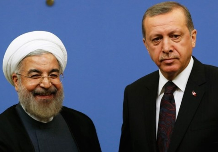 Iran's President Hassan Rouhani shakes hands with Turkish Prime Minister Tayyip Erdogan