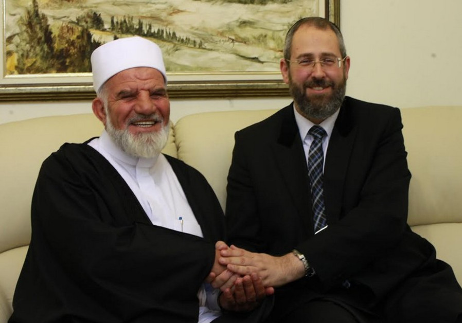 Chief Rabbi David Lau (R) met with Sheikh Muhammad Kiwan
