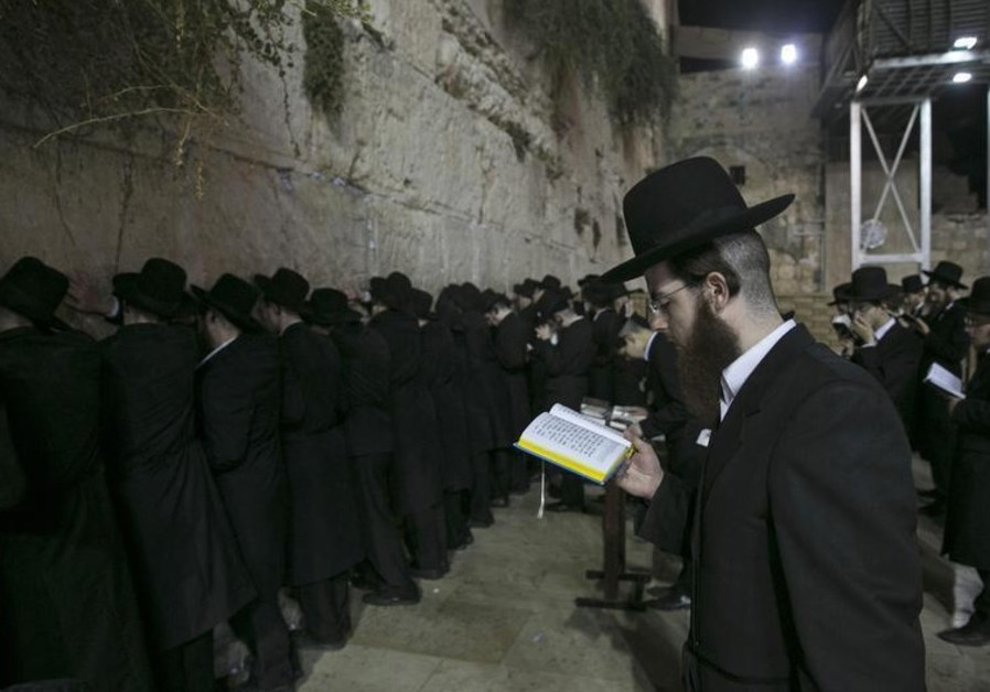 Religious Jews pray at the Western Wall