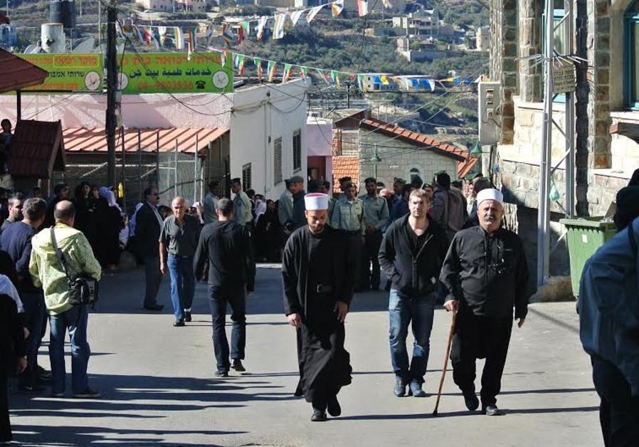 BEIT JANN residents arrive for the funeral of Border Police officer Jidan Assad.