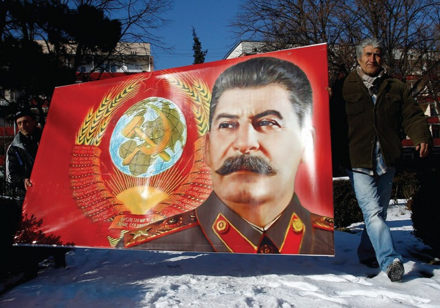 PEOPLE CARRY a poster with a portrait of late Soviet dictator Josef Stalin