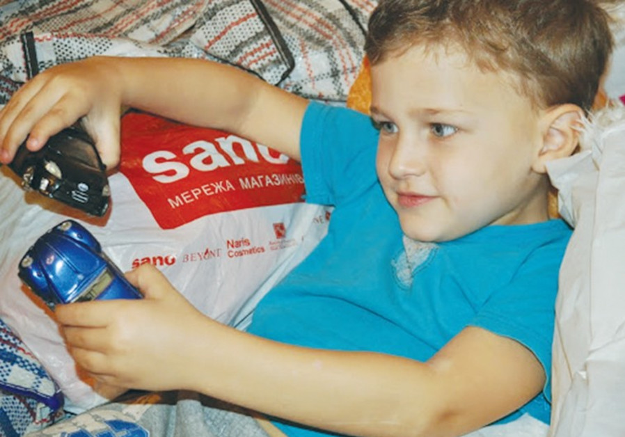 A CHILD whose family fled from Donetsk