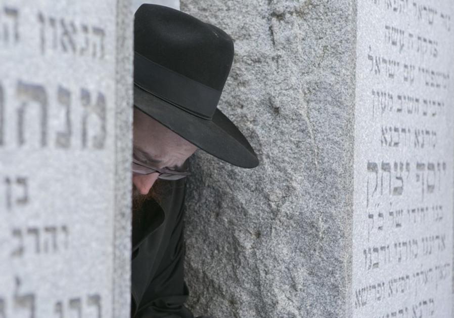A Chabad-Lubavitch rabbi reflects at the gravesite of the Lubavitcher Rebbe, Rabbi Menachem M. Schne