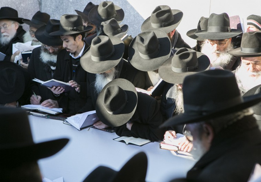 Rabbis pray at the gravesite of the Lubavitcher Rebbe, Rabbi Menachem M. Schneerson