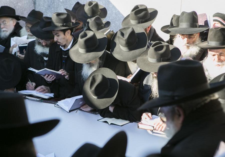 Rabbis pray at the gravesite of the Lubavitcher Rebbe, Rabbi Menachem M. Schneerson