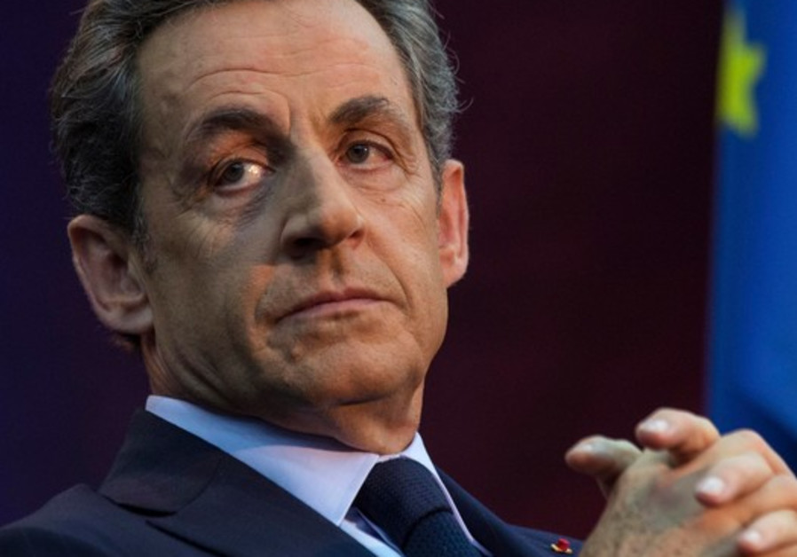 Image result for Sarkozy released from custody and accused of illegally funding the presidential campaign