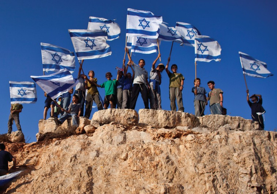 Jewish youths wave flag
