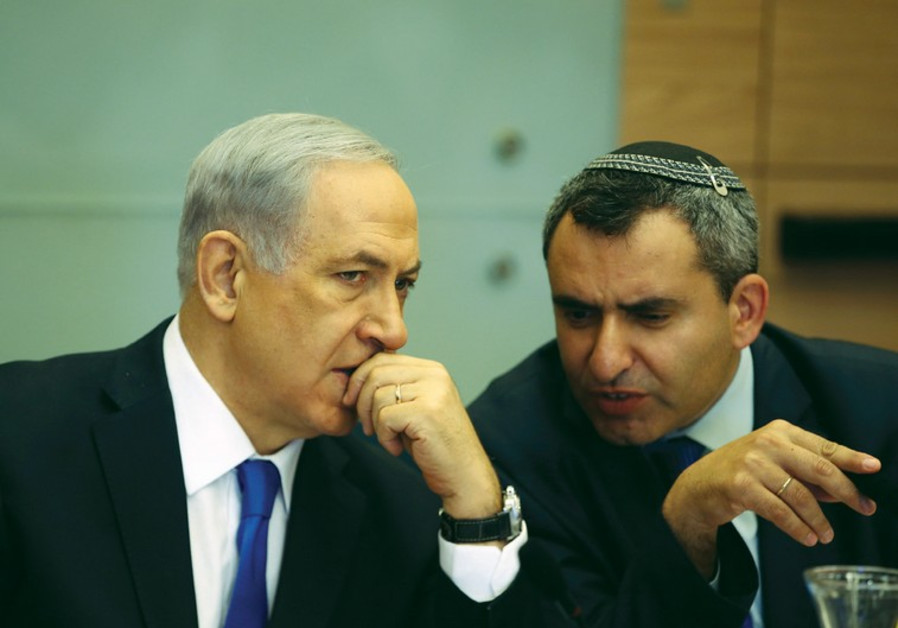 Prime Minister Benjamin Netanyahu listens to Zeev Elkin during a committee meeting at the Knesset in