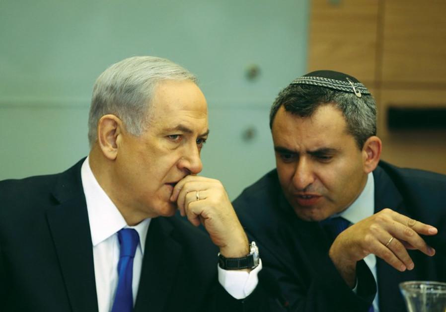Prime Minister Benjamin Netanyahu listens to Zeev Elkin during a committee meeting at the Knesset in