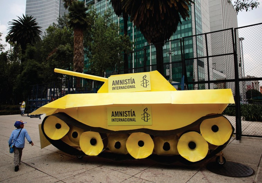 A child walks around a fake tank parked outside the US embassy