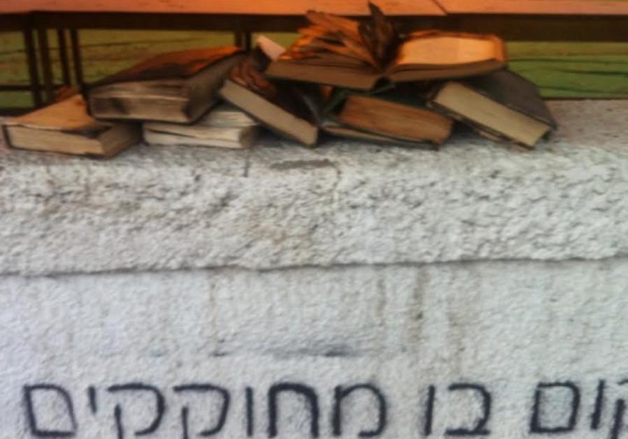 Burned books and graffiti at Tel Aviv synagogue