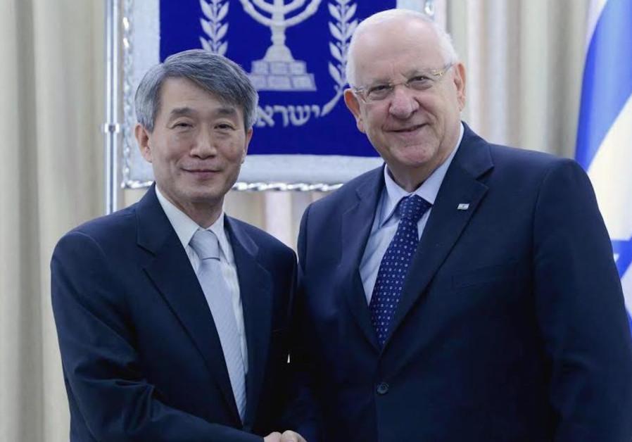 PRESIDENT REUVEN RIVLIN (R) and Lee Gun-Tae, the new Korean envoy