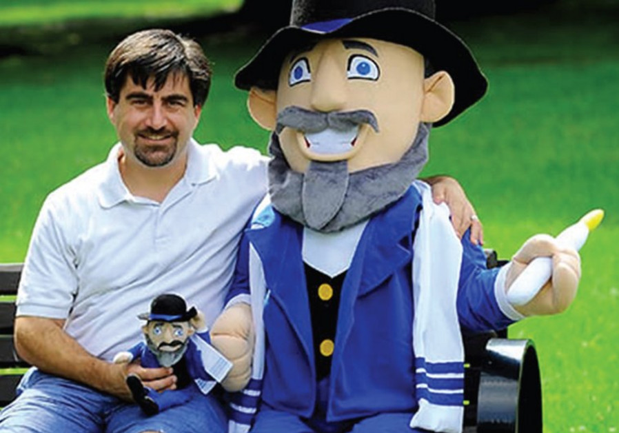 AMERICAN TOYMAKER Neal Hoffman poses with a prototype of his Mensch on a Bench.