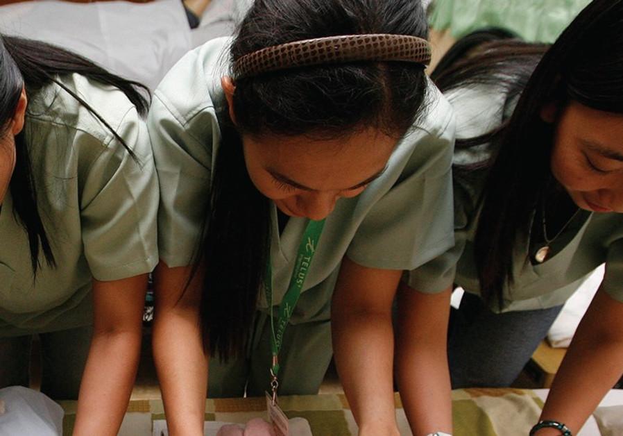 Filipina caregivers training in Manila