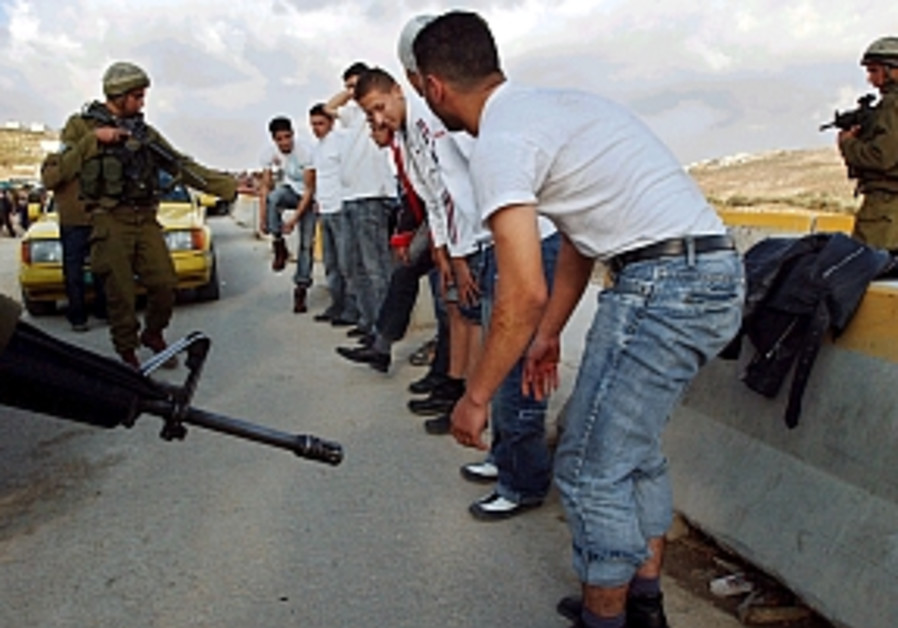 idf soldiers check row of palestinians hawara 298