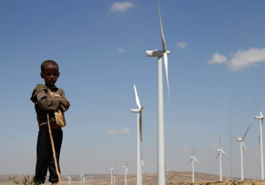 A BOY stands in front of wind turbines at the Ashegoda Wind Farm north of Addis Ababa.