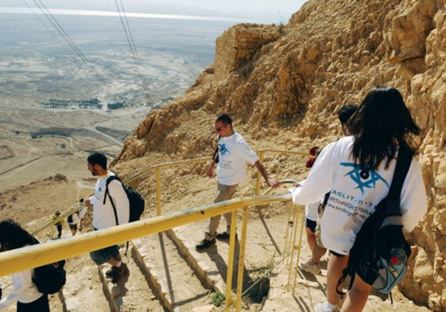 A TAGLIT-BIRTHRIGHT group climbs down the slope of Masada