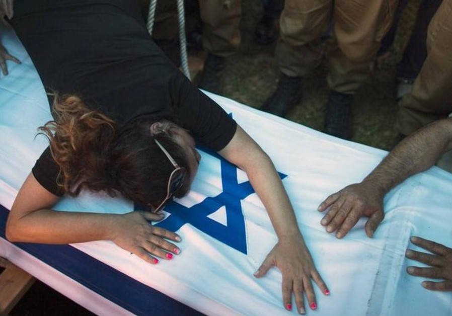 The mother of an IDF soldier killed in Gaza mourns over his coffin
