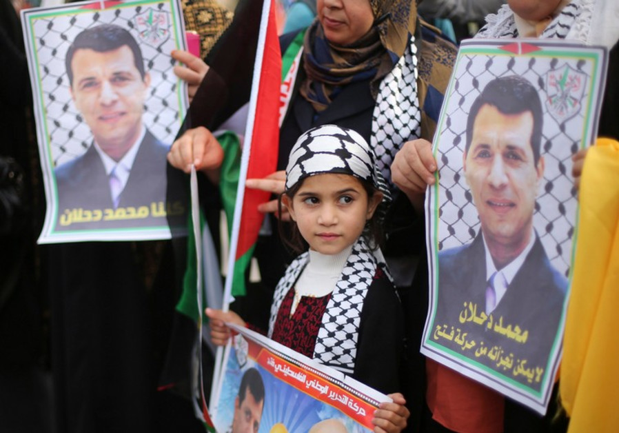 Palestinians hold posters of Mohammed Dahlan during a Gaza rally, December 18, 2014