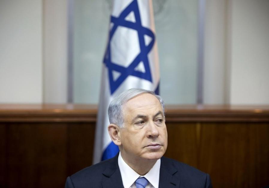 Bibi scowls in front of Israeli flag