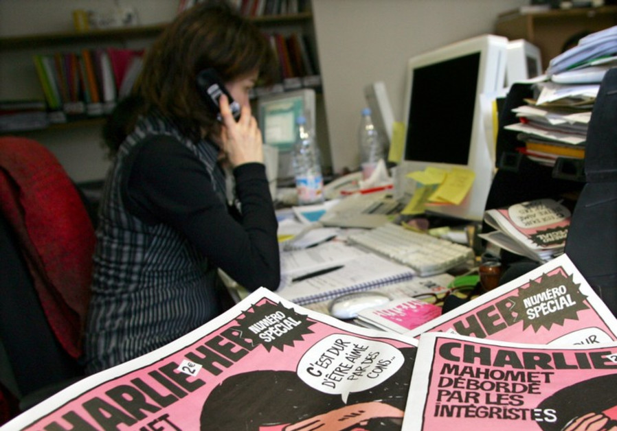"""Copies of the French satirical weekly """"Charlie Hebdo"""" are seen in its Paris newsroom"""