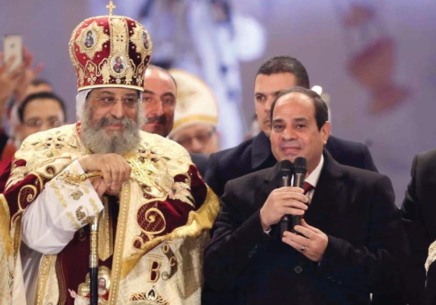 EGYPTIAN PRESIDENT Abdel Fattah al-Sisi speaks next to Coptic Pope Tawadros II