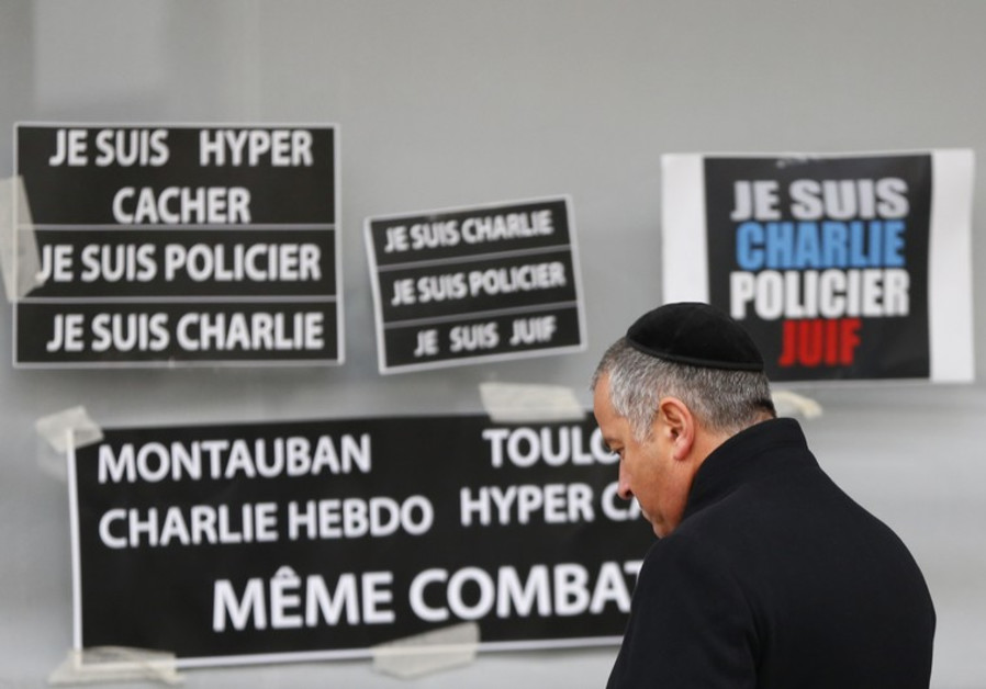 French Jewish man pays repsects to victims of terror attack