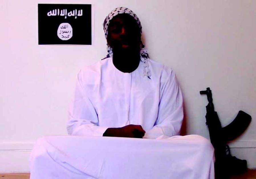 Amedy Coulibaly devant le drapeau de Daesh